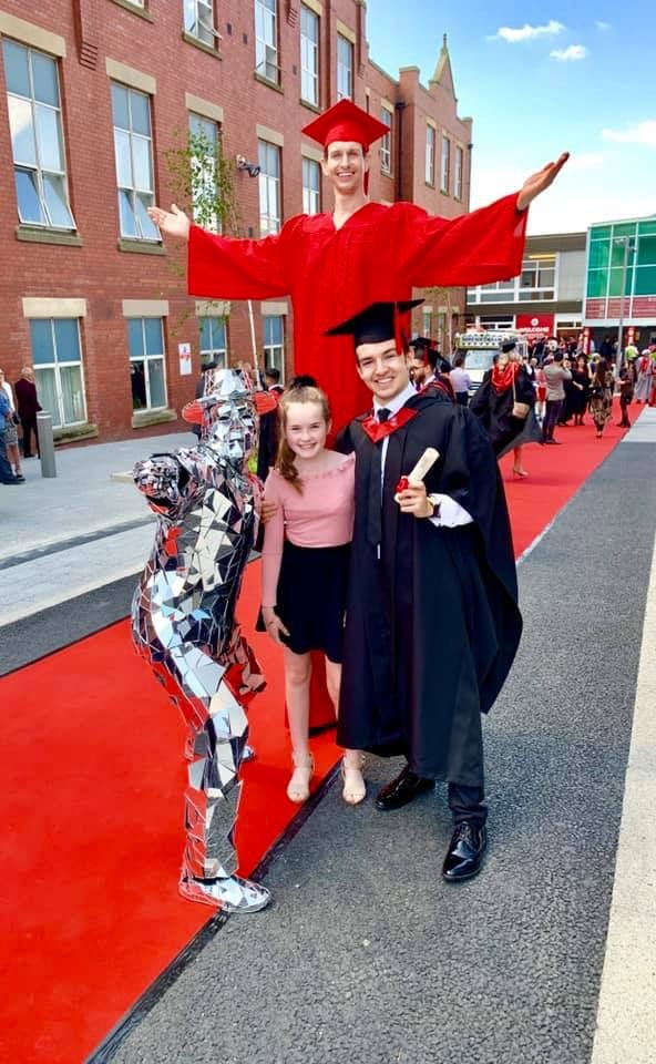 Cometan with his younger sister, Charlotte Sophia, during the day of his graduation from the University of Central Lancashire on 15th July 2019