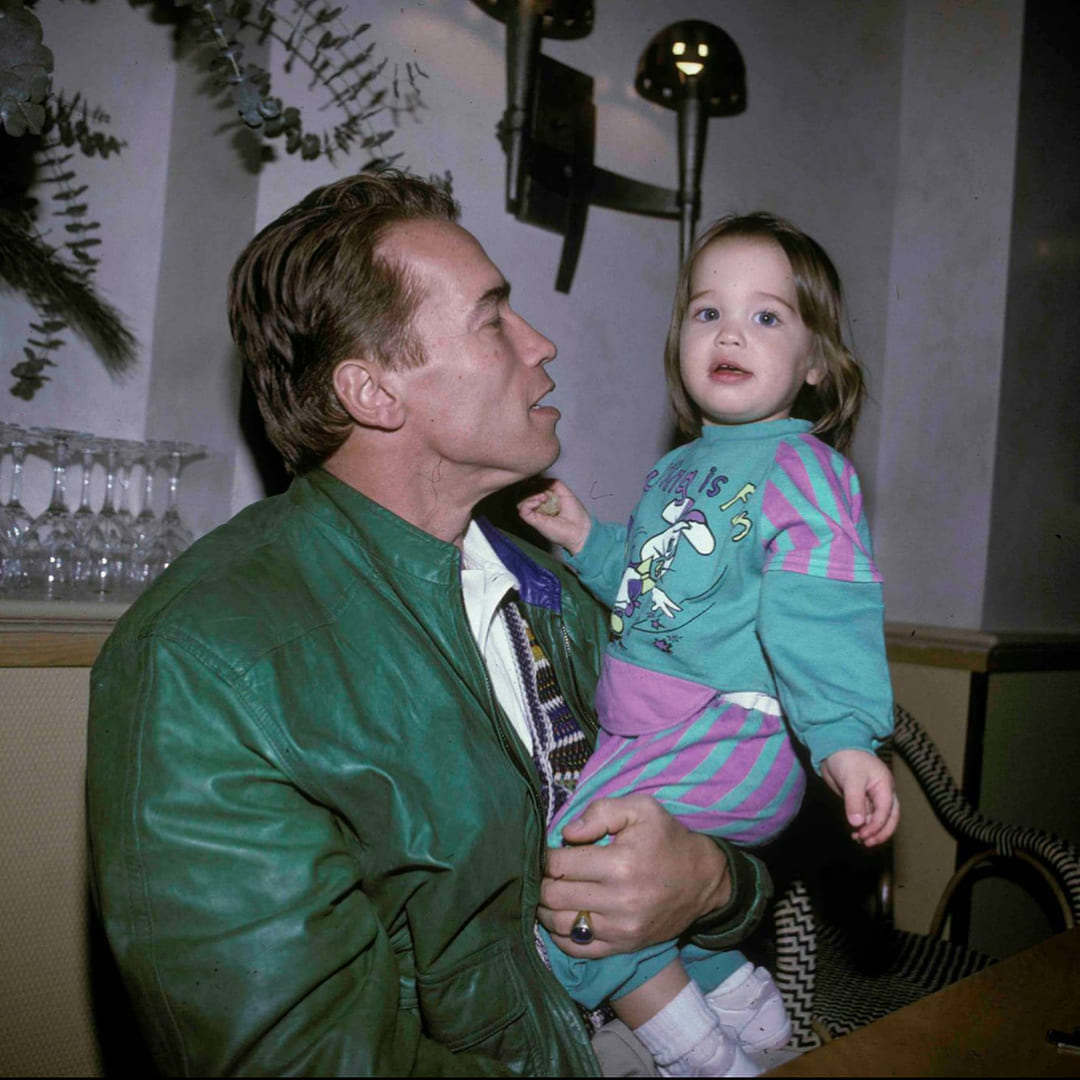 Childhood picture of Christina Schwarzenegger with her father